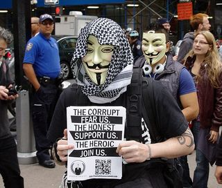 706px-Occupy_Wall_Street_Anonymous_2011_Shankbone