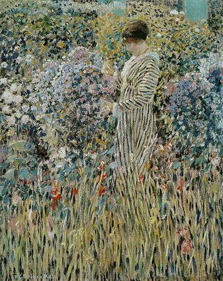 476px-Frederick_Carl_Frieseke_-_Femme_dans_un_jardin