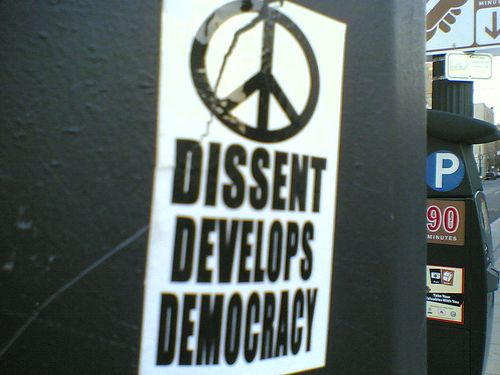 800px-Dissent_develops_democracy_sticker