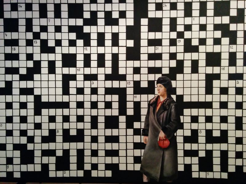 Crossword_puzzle_with_lady_in_black_coat