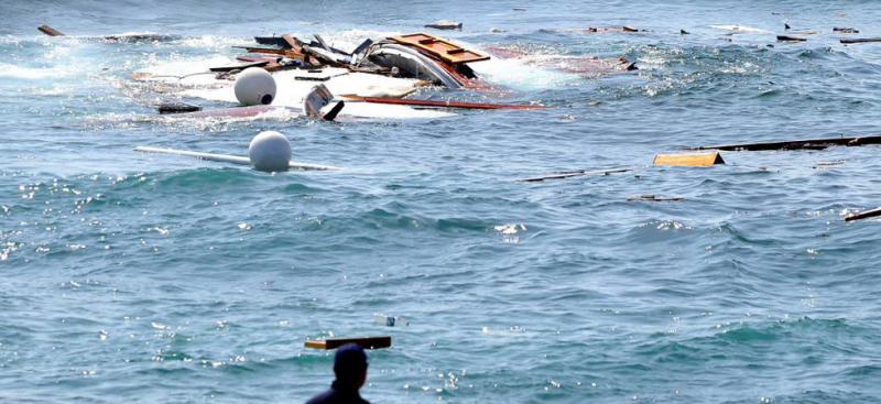 CroppedMigrants and refugees are rescued from a wooden boat off Libya on Monday. Photo: AP -missmigrant