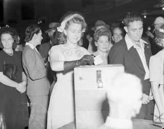 Miss_E._S._O'Brien_putting_her_vote_into_the_box_at_the_City_Hall_Brisbane_1947_(27895206401)