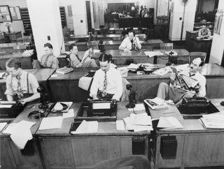 He_New_York_Times_newsroom_1942