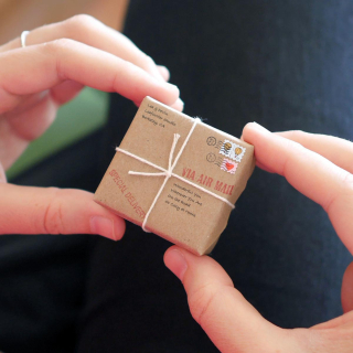 Tiny-packages-in-hand