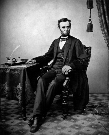 Lincoln with pen and paper