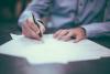 Man_signing_document